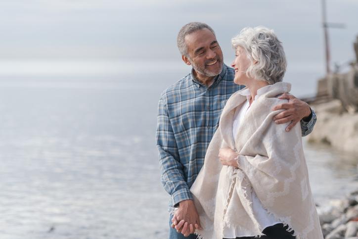 Laughing senior couple on a beach